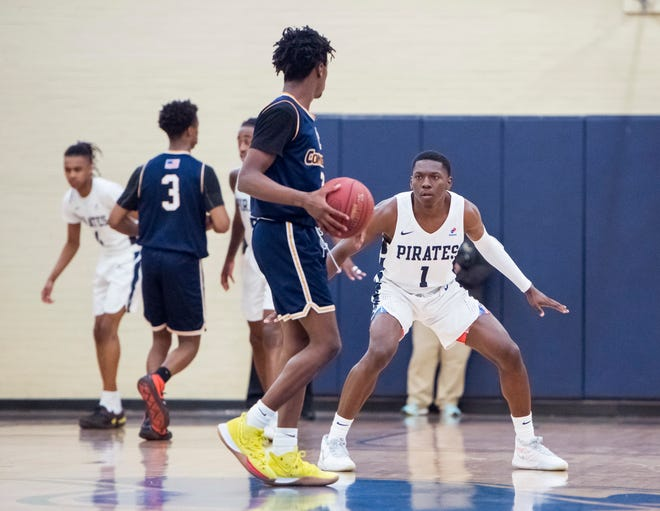 DJ McKenzie (1) plays defense during the Gulf Coast State vs Pensacola State men's basketball game at Pensacola State College on Wednesday, Jan. 22, 2020. The Catholic High graduate has been a defensive anchor for the Pirates.