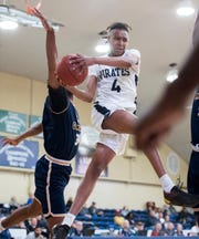 Adrian Walker (4) takes it to the hoop during the Gulf Coast State vs Pensacola State men's basketball game at Pensacola State College on Wednesday, Jan. 22, 2020.