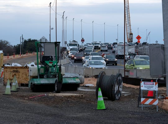 Drivers on Thursday travel across the replacement span of the Pensacola Bay Bridge as construction on the second span and the pedestrian paths continues.