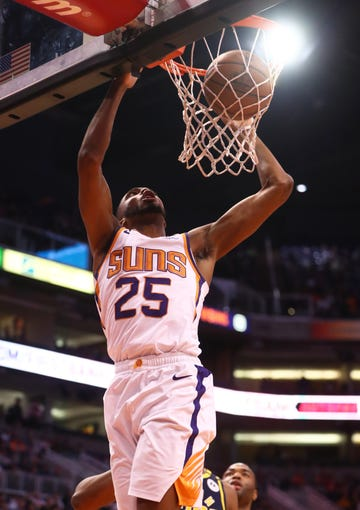 Jan 22, 2020; Phoenix, Arizona, USA; Phoenix Suns forward Mikal Bridges (25) dunks the ball against the Indiana Pacers in the first half at Talking Stick Resort Arena. Mandatory Credit: Mark J. Rebilas-USA TODAY Sports