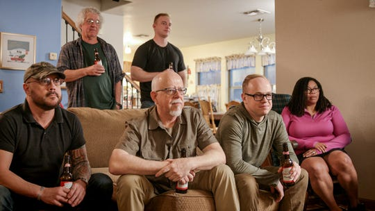 Mason Miller and Bernie Miller (center right and left) of Peoria went viral in 2014 when Mason surprised his dad at work after returning early from his tour in Afghanistan. The touching clip is included in a Budweiser commercial that will air during the 2020 Super Bowl LIV on Feb. 2.
