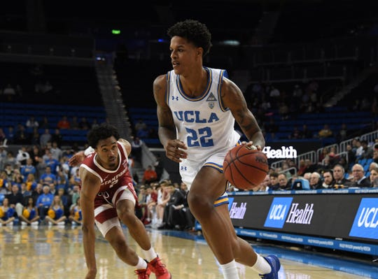 UCLA Bruins forward Shareef O'Neal (22) is defended by Stanford Cardinal guard Bryce Wills (2) in the second half at Pauley Pavilion.