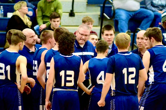 Yale coach Pat Bondy talks to his team at a timeout break against Imlay City during a Blue Water Area Conference boys basketball game on Wednesday, Jan. 22, 2020.