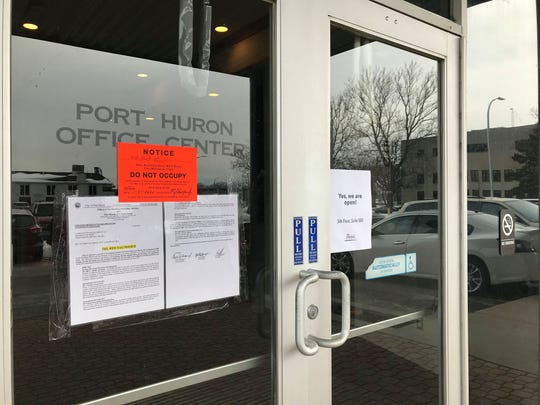 A pre-red tag notice on the office building doors at 511 Fort St. in Port Huron on Jan. 23, 2020.