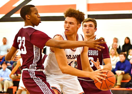Gettysburg's Quadir Copeland, left, and Zach Ketterman, right, work to box in York Suburban's Aidan Hughley during boys' basketball action at York Suburban Senior High School in Spring Garden Township, Wednesday, Jan. 22, 2020. Gettysburg would win the game 67-61. Dawn J. Sagert photo