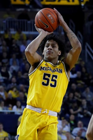 Michigan guard Eli Brooks shoots against Penn State in the second half of an NCAA college basketball game in Ann Arbor, Mich., Wednesday, Jan. 22, 2020. (AP Photo/Paul Sancya)