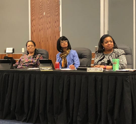 York City school board members Arleta Riviera (left) and Cassandra Liggins (middle), along with Superintendent Andrea Berry, listen to school police Chief Michael Muldrow explain the Juvenile Violence Truancy Initiative, which was approved by the board Wednesday, Jan. 22.
