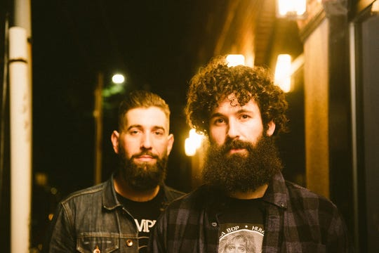 Band members Pat Faherty and Matt Stubbs pose for a photo.