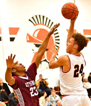 York Suburban's Aidan Hughley, right, aims for the basket while Gettysburg's Quadir Copeland defends during boys' basketball action at York Suburban Senior High School in Spring Garden Township, Wednesday, Jan. 22, 2020. Gettysburg would win the game 67-61. Dawn J. Sagert photo