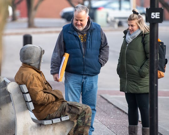 Steve Brubaker, interim CEO of LifePath Christian ministries (center), and Alexandra Smith of the York County Planning Commission (right) ask a York resident if he knows any places where homeless people tend to go in the morning, during a count on Thursday.