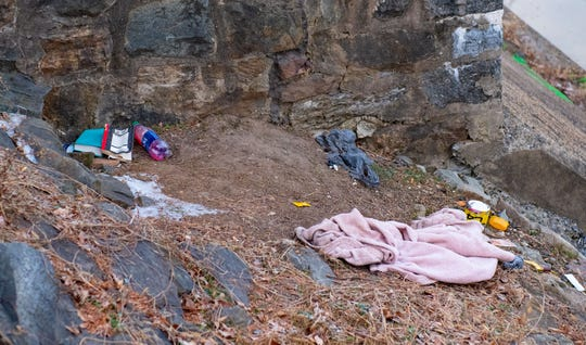 Blankets, books, and leftover water bottles are found alongside the Codorus Creek across during a homeless count.