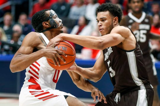 St. Bonaventure's Jaren English (5) steals the ball from Dayton's Rodney Chatman (0) during the second half of an NCAA college basketball game, Wednesday, Jan. 22, 2020, in Dayton, Ohio.