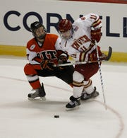 RIT's Chris Saracino, left, ties up Denver's Chris Knowlton  in RIT's 2-1 win over Denver in the NCAA East Regional semifinals on March 26, 2010 in Albany.