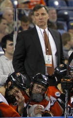 RIT's head coach Wayne Wilson looks on during NCAA Frozen Four semifinal hockey action between the Wisconsin Badgers and the RIT Tigers at Ford Field in Detroit, Michigan Thursday evening, April 8, 2010.