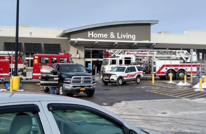 Firefighters respond to fire at Walmart store in Geneva on Wednesday.