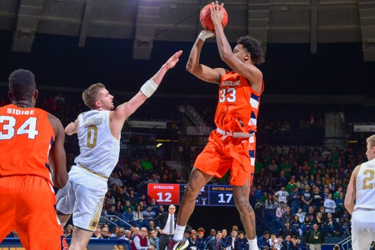 Syracuse Orange forward Elijah Hughes (33) shoots over Notre Dame Fighting Irish guard Rex Pflueger (0) in the first half at the Purcell Pavilion in South Bend, Indiana.