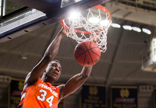 Syracuse's Bourama Sidibe(34) dunks during the second half of an NCAA college basketball game against Notre Dame on Wednesday, Jan. 22, 2020, in South Bend, Ind. Syracuse won 84-82