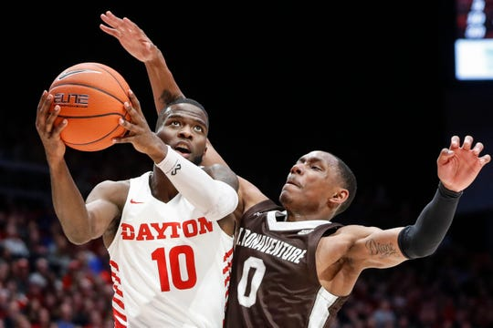 Dayton's Jalen Crutcher (10) shoots against St. Bonaventure's Kyle Lofton (0) during the first half of an NCAA college basketball game, Wednesday, Jan. 22, 2020, in Dayton, Ohio. (AP Photo/John Minchillo)