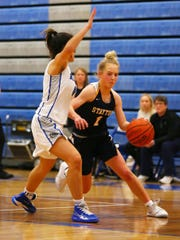 Stayton's KJ Nyquist, 1, drives the ball towards the basket against Woodburn's Aria Kent, 0.