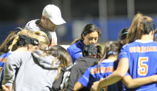San Angelo Central High School head girls soccer coach Ben Henry and the Lady Cats gather in prayer before their match against Midland High at the San Angelo Sports Complex/Old Bobcat Field on Wednesday, Jan. 22, 2020.