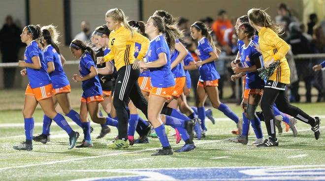 The San Angelo Central High School girls soccer team gets a little running in after a match with Midland High at the San Angelo Sports Complex/Old Bobcat Field on Wednesday, Jan. 22, 2020.