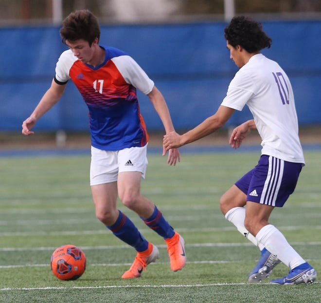 San Angelo Central High School's Dylan Caudle fends off a Midland High player at the San Angelo Sports Complex/Old Bobcat Field on Wednesday, Jan. 22, 2020.