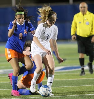 San Angelo Central High School's Aspen Connell, 9, tries to steal the ball away from a Midland High player earlier in the 2020 season.