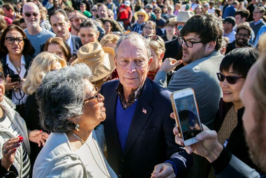Democratic presidential candidate Michael Bloomberg walks through a crowd of supporters at a rally at Central Machine Works in East Austin.