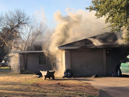 Smoke pours out of a San Angelo home in the 3600 block of South Oxford Drive on Thursday, Jan. 23, 2020.