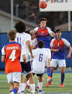 San Angelo Central High School's Dylan Caudle makes a header against Midland High at the San Angelo Sports Complex/Old Bobcat Field on Wednesday, Jan. 22, 2020.