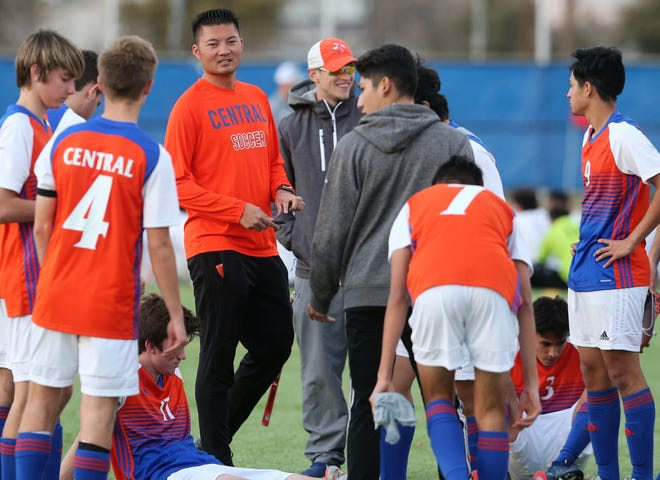 San Angelo Central High School head boys soccer coach Tony Vu talks to the Bobcats during halftime of their match with Midland High at the San Angelo Sports Complex/Old Bobcat Field on Wednesday, Jan. 22, 2020.