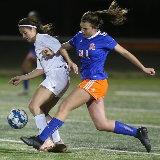 San Angelo Central High School's Riley Herbert, 21, battles a Midland High player for the ball during a nondistrict match at the San Angelo Sports Complex/Old Bobcat Field on Wednesday, Jan. 22, 2020. It ended in a 0-0 tie.