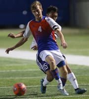 San Angelo Central High School's Triston Hill fights off a Midland High player for the ball during a game at the San Angelo Sports Complex/Old Bobcat Field on Wednesday, Jan. 22, 2020.