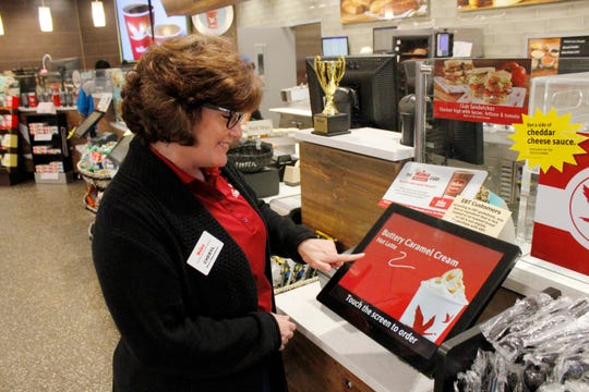 Wawa General Manager Cheryl McAroy demonstrates how to use the store's touch screen at the North Salisbury Wawa on Tuesday, Jan. 14.
