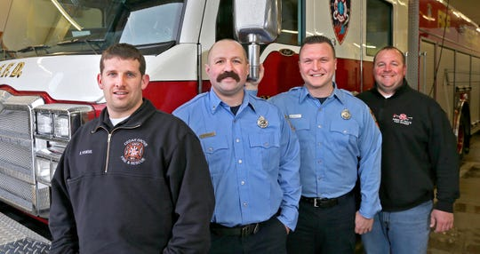 "Hometown Heros - from left; Cedar Grove Fire Department's Kyle Voskuil; Sheboygan Fire Department's Kurt Miller; Sheboygan Fire Department's Adam Grandlic and Town of Sheboygan Falls' Matt Kroeplien pose, Thursday, January 23, 2020, in Sheboygan, Wis. The firefighters were part of the Sheboygan County Technical Rescue Team were recognized Tuesday at the Capital by the state Assembly as ""Hometown Heroes"" for the rescue at Cargill Malting in Sheboygan last August."