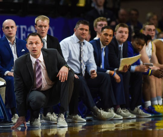 SDSU head coach Eric Henderson watches the game against NDSU from the sidelines on Wednesday, Jan. 22, 2020 at Frost Arena in Brookings, S.D.