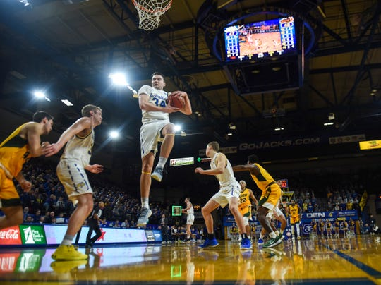SDSU's Alex Arians (34) rebounds the ball off of a NDSU shot during the game on Wednesday, Jan. 22, 2020 at Frost Arena in Brookings, S.D.