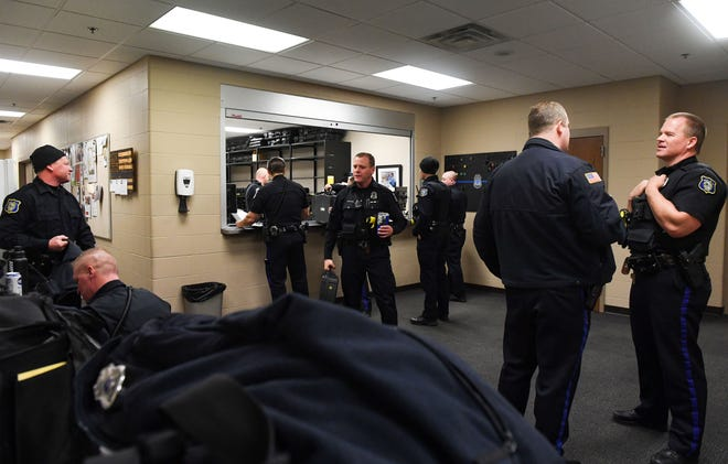 Police officers grab gear to start their shift at 8 a.m. on Thursday, Jan 23, at the Law Enforcement Center in Sioux Falls.