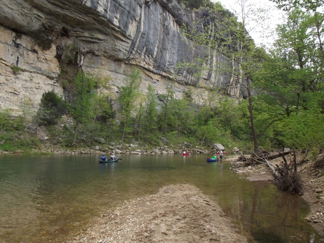 Soaring bluffs provide a breathtaking view during a spring float on the Buffalo River in Arkansas. The National Park Service has decided to close the Buffalo National River Park due to heavy use by visitors in recent days.