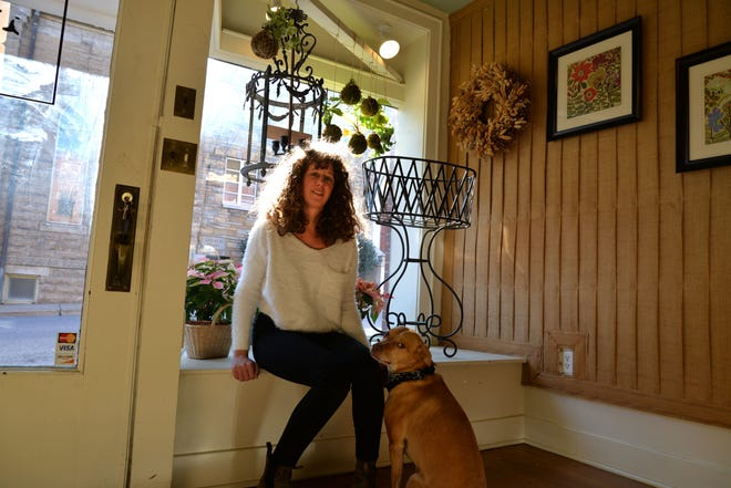Brin's Posy brought owner Cailyn Siegman out of slump when her dog passed away. Now her floral arrangements bring happiness to her customers. Her new storefront is located on West Beverley Street near historic downtown. Here she is pictured with her dog, Abby.