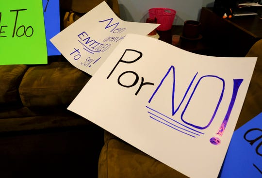 Signs are ready for used Wednesday, Jan. 22, 2020, in an upcoming demonstration for trafficking awareness month at the Central Minnesota Sexual Assault Center in St. Cloud.