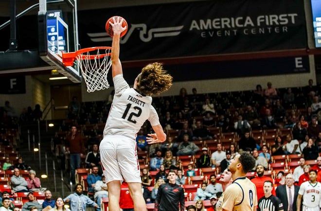 SUU's Maizen Fausett rises for a dunk.