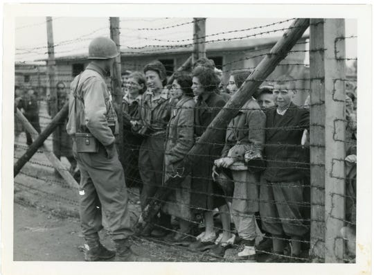 A U.S. soldier greets liberated prisoners at Mauthausen concentration camp, May, 1945.
