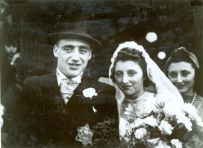 Salomon and Flora Schrijver's wedding with visible Star of David patch.  Image credit: The Florida Holocaust Museum, courtesy of Samuel Schryver, formerly of Clearwater, FL