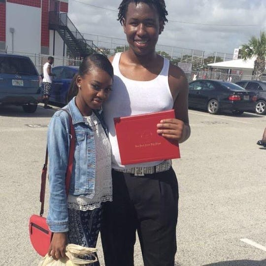 Carltravius Jones poses with his sister, Naomi Bell, on the day of Jones' graduation from Vero Beach High School in 2017. Jones died Sunday, January 19, 2020 after being shot during a drug transaction, according to the Indian River County Sheriff's Office.