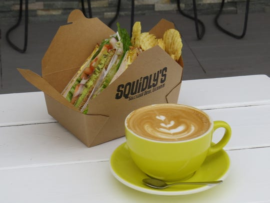 """A turkey sandwich and latte are seen at Squidly's Coffee, a nonprofit restaurant in Oxnard's Hollywood Beach neighborhood. """"I want people to be wowed. I want them to leave thinking, 'I got my money's worth and I helped a child,'"""" says founder Tammy Morrell."""