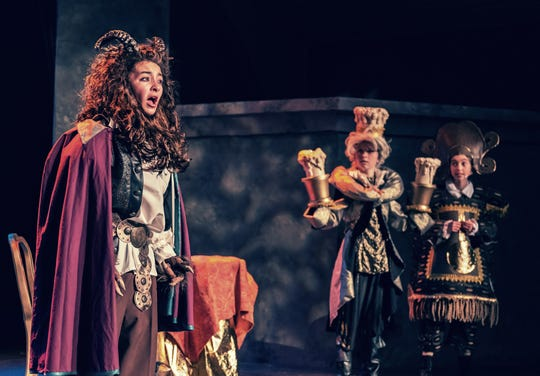 """Beast, played by Genevieve Rosas and Lumiere, played by Lily Giuliani and Cogsworth played by Ada Sheeran perform in Disney's """"Beauty and the Beast, Jr.""""  The production by the Ojai Youth Entertainers Studio at theOjai Valley Community Church continues through Feb. 9."""