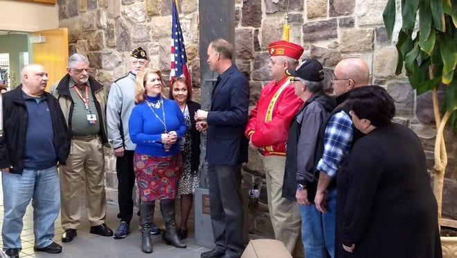 (From left) Paul Spinelli, president, Vineland City Council; Matthew Jordan, advisory board chairperson, New Jersey Veterans Memorial Home; Ron Secchiutti, president, United Veterans Council of Vineland; Lisa Williams, supervisor of recreation, NJVMH; Allyson F. Bailey, chief executive officer, NJVMH; Russell Swanson, executive director, Main Street Vineland; Edwin F. Alicea Sr., vice president, UVCV; Robert A. Tesoroni Jr., past president, UVCV; George Perez, mural artist; and Josephine Spinelli, chairperson, mural dedication ceremony; were present as Main Street Vineland presented a donation of $500 to the New Jersey Veterans Memorial Home to benefit the residents. The donation represented money raised from the public and other sources by Main Street Vineland in excess of funds required to complete the military mural in downtown Vineland.