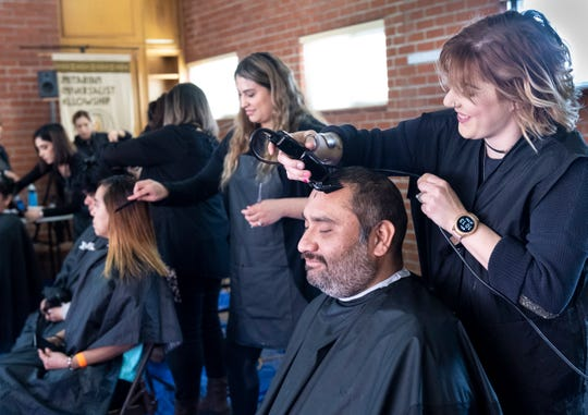 Adolfo Casteneda gets a haircut from Dakota Blue during Homeless Connect at St. Paul's Church on Jan. 23, 2020. Many services for people experiencing homelessness have been reduced or compromised as a result of the COVID-19 pandemic.