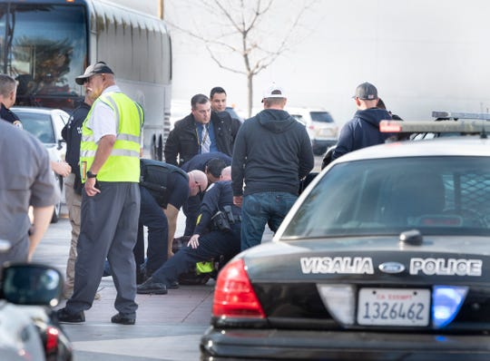 Visalia Police take a man into custody after a transit bus was taken while the route driver stepped away on Thursday, January 23, 2020. The man was taken into custody when he stopped at the Visalia Transit Center.